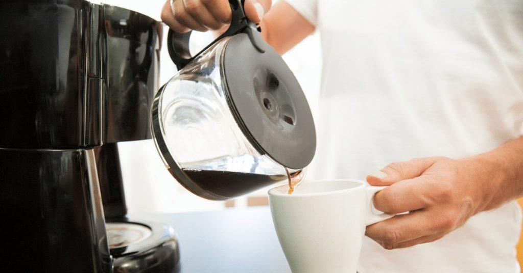 man pouring coffee into a mug